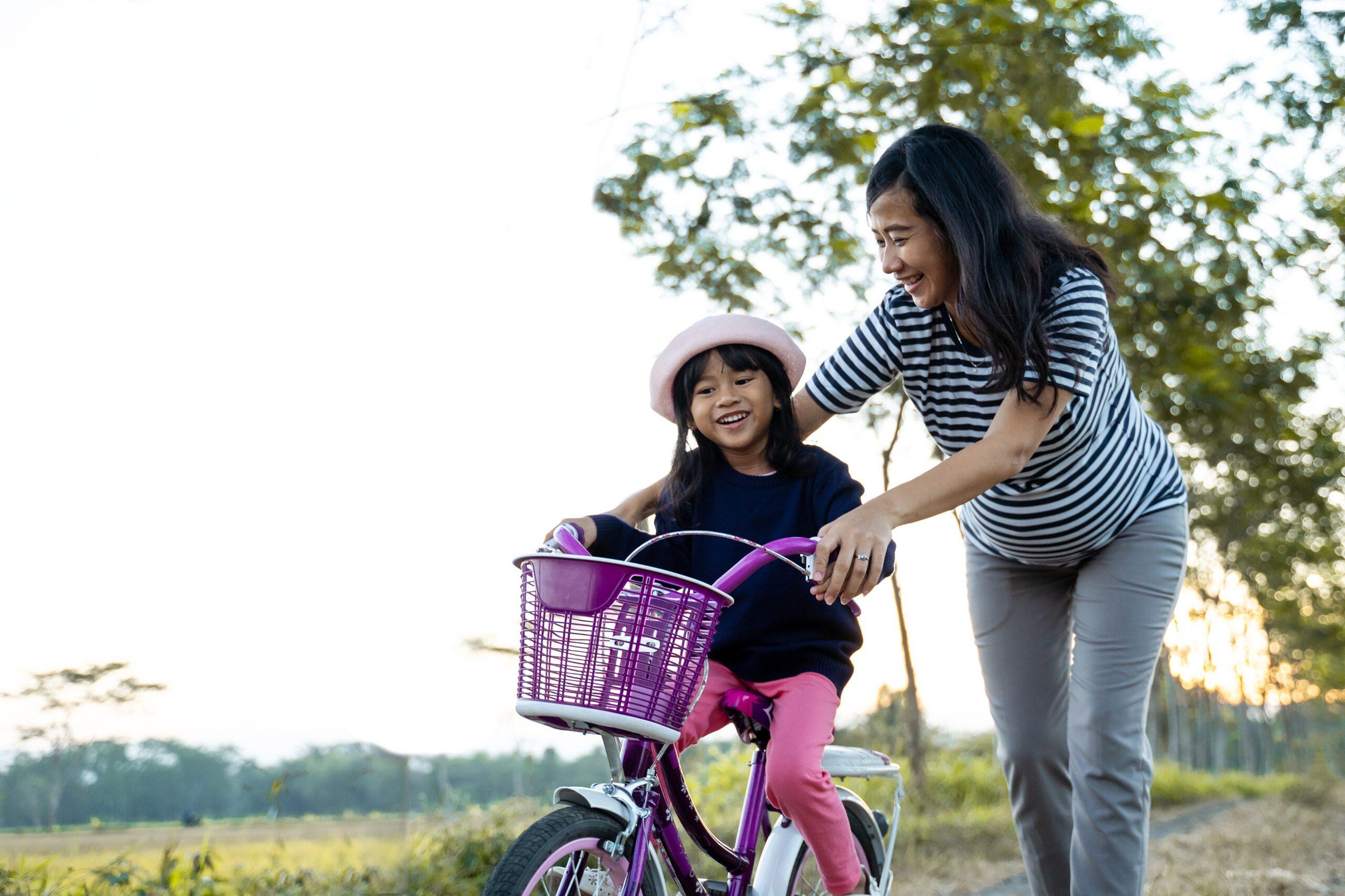 teaching a kid how to ride a bike
