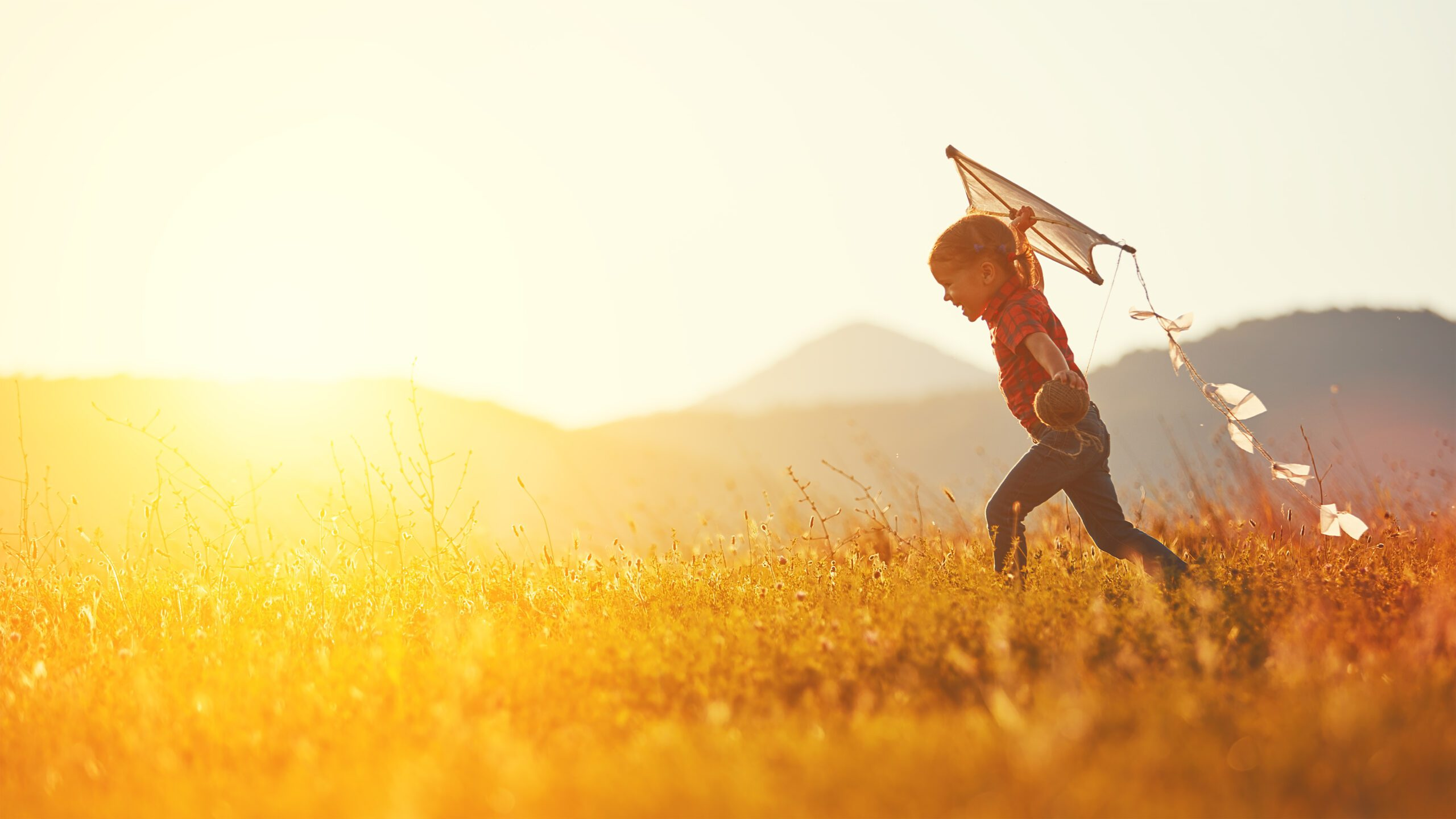 independent child flying a kite